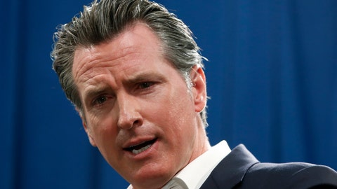 <p>               FILE - In this Sept. 16, 2019, file photo, Gov. Gavin Newsom answers a question during a news conference in Sacramento, Calif. Newsom announced Monday, Sept. 30, he signed a law that would let athletes at California universities make money from their images, names or likenesses. The law also bans schools from kicking athletes off the team if they get paid. (AP Photo/Rich Pedroncelli, File)             </p>