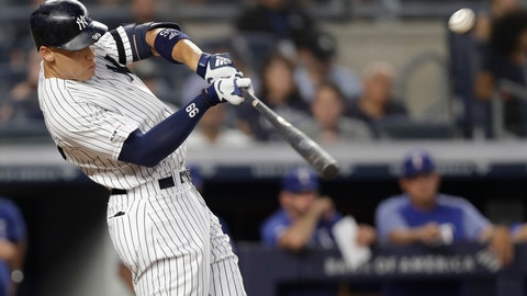 <p>               New York Yankees' Aaron Judge hits a two-run home run during the third inning of the team's baseball game against the Texas Rangers, Wednesday, Sept. 4, 2019, in New York. (AP Photo/Kathy Willens)             </p>