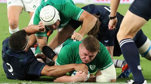 <p>               Ireland's Tadhg Furlong, center, carries a ball to score the teams' third try during the Rugby World Cup Pool A game at International Stadium between Ireland and Scotland in Yokohama, Japan, Sunday, Sept. 22, 2019. (AP Photo/Eugene Hoshiko)             </p>