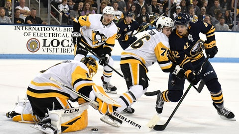 <p>               Pittsburgh Penguins' goalie Casey DeSmith (1) blocks a shot from Buffalo Sabres' Dylan Cozens (42) as Penguins' Calen Addison (76) defends during the first period of an NHL preseason hockey game Monday, Sept.16, 2019, in State College, Pa. (AP Photo/John Beale)             </p>