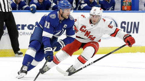 <p>               Tampa Bay Lightning center Steven Stamkos (91) looks to pass the puck around Carolina Hurricanes forward Colin Markison (92) during the first period of an NHL preseason hockey game Tuesday, Sept. 17, 2019, in Tampa, Fla. (AP Photo/Chris O'Meara)             </p>