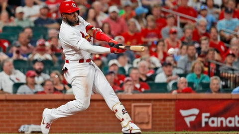 <p>               St. Louis Cardinals' Marcell Ozuna hits a ground-rule double to score two runs during the seventh inning of a baseball game against the Washington Nationals, Monday, Sept. 16, 2019, in St. Louis. (AP Photo/Jeff Roberson)             </p>