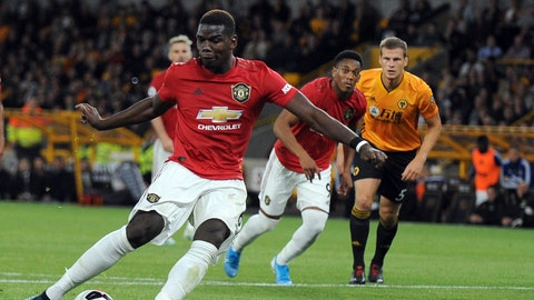 <p>               Manchester United's Paul Pogba, front, fails to score penalty shot during the English Premier League soccer match between Wolverhampton Wanderers and Manchester United at the Molineux Stadium in Wolverhampton, England, Monday, Aug. 19, 2019. (AP Photo/Rui Vieira)             </p>