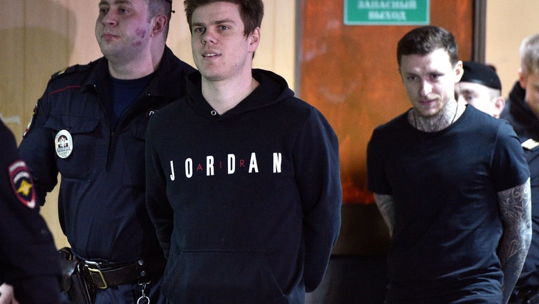 2 Russian soccer players let out on parole in brawl case