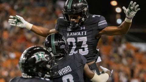 <p>               Hawaii wide receiver JoJo Ward (9) lifts his teammate wide receiver Jared Smart (23) celebrating his touch down reception during the second half of an NCAA college football game against Oregon State, Saturday, Sept. 7, 2019, in Honolulu. (AP Photo/Eugene Tanner)             </p>