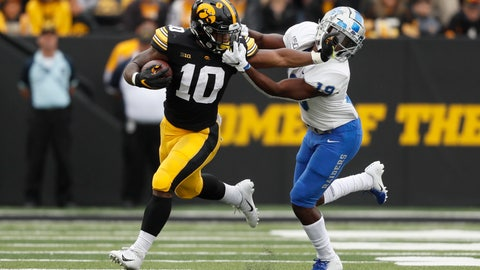 <p>               Iowa running back Mekhi Sargent (10) tries to break a tackle by Middle Tennessee cornerback Teldrick Ross, right, during the first half of an NCAA college football game, Saturday, Sept. 28, 2019, in Iowa City, Iowa. (AP Photo/Charlie Neibergall)             </p>