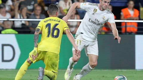 <p>               Real Madrid's Gareth Bale, vies withe Villareal's Xavi Quintilla during the Spanish La Liga soccer match between Villarreal and Real Madrid in the Ceramica stadium in Villarreal, Spain, Sunday, Sept. 1, 2019. (AP Photo/Alberto Saiz)             </p>