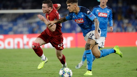 <p>               Napoli's Giovanni Di Lorenzo, right, tries to stop Liverpool's Andrew Robertson during the Champions League Group E soccer match between Napoli and Liverpool, at the San Paolo stadium in Naples, Italy, Tuesday, Sept. 17, 2019. (AP Photo/Gregorio Borgia)             </p>