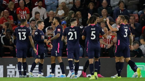 <p>               Bournemouth's Harry Wilson, second left, celebrates with teammates after scoring his side's opening goal during the English Premier League soccer match between Southampton and Bournemouth at St Mary's stadium in Southampton, England, Friday, Sept. 20, 2019. (AP Photo/Kirsty Wigglesworth)             </p>