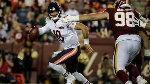 <p>               Chicago Bears quarterback Mitchell Trubisky (10) works to escape Washington Redskins defensive end Matthew Ioannidis (98) during the second half of an NFL football game Monday, Sept. 23, 2019, in Landover, Md. (AP Photo/Julio Cortez)             </p>