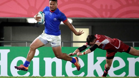 <p>               Samoa's Alapati Leiua runs past Russia's Vasily Artemyev to score a try during the Rugby World Cup Pool A game between Russia and Samoa at Kumagaya Rugby Stadium, Kumagaya City, Japan, Tuesday, Sept. 24, 2019. Samoa defeated Russia 34-9. (AP Photo/Jae Hong)             </p>