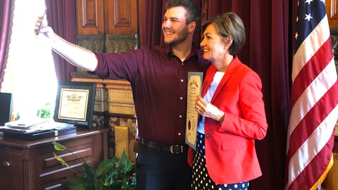<p>               Carson King, of Altoona, Iowa, snaps a selfie Wednesday, Sept. 25, 2019, in the Iowa State Capitol in Des Moines, Iowa, with Iowa Gov. Kim Reynolds, who holds a proclamation declaring Saturday as Carson King Day. The honor was to mark King's plans to donate more than $1 million to charity after his decision to display a hand-written sign before the Sept. 14 Iowa State-Iowa football game seeking money for beer prompted an overwhelming number of donations. (AP Photo/David Pitt)             </p>