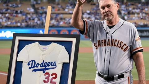 <p>               San Francisco Giants manager Bruce Bochy acknowledges the crowd after receiving a signed Sandy Koufax jersey to commemorate his last series at Dodger Stadium as Giants manager, prior to the team's baseball game against the Los Angeles Dodgers in Los Angeles, Friday, Sept. 6, 2019. (AP Photo/Kelvin Kuo)             </p>