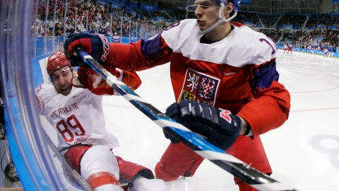 <p>               FILE - In this Feb. 23, 2018, file photo, Czech Republic' Dominik Kubalik (18) checks Russia's Nikita Nesterov (89) during the second period of the semifinal round of the men's hockey game at the 2018 Winter Olympics in Gangneung, South Korea. Kubalik is one of the biggest variables for the Chicago Blackhawks as they try to get back to the playoffs after a two-year absence. He could play on one of Chicago's top lines, but he isn't looking too far ahead early in training camp. (AP Photo/Julio Cortez, File)             </p>