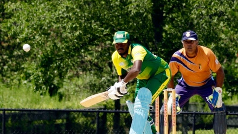 <p>               In this Sunday, Aug. 11, 2019 photo, Pioneer Cricket Club batsman prepares to swing as a Staten Island Cricket Club slip watches from behind the wickets during match in the Brooklyn borough of New York. Despite their familiar languages, Staten Island CC, unlike most other teams on the New York City cricket circuit, does not have a dominant religion or ethnicity.  (AP Photo/Avery Yang)             </p>