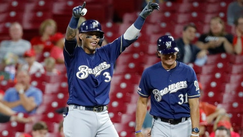 <p>               Milwaukee Brewers' Orlando Arcia reacts after reaching on a bunt single off Cincinnati Reds relief pitcher Kevin Gausman during the ninth inning of a baseball game, Tuesday, Sept. 24, 2019, in Cincinnati. (AP Photo/John Minchillo)             </p>