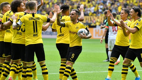 <p>               File---Picture taken Aug.17, 2019 shows Dortmund's Paco Alcacer holding the ball as he celebrates after scoring his side's first goal during the German Bundesliga soccer match between Borussia Dortmund and FC Augsburg at the Signal Iduna Park stadium in Dortmund, Germany. (AP Photo/Martin Meissner)             </p>