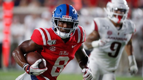 <p>               Mississippi wide receiver Elijah Moore (8) runs past Arkansas defenders on his way to a touchdown reception during the second half of an NCAA college football game, Saturday, Sept. 7, 2019, in Oxford, Miss. Mississippi won 31-17. (AP Photo/Rogelio V. Solis)             </p>