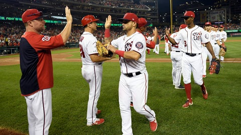 <p>               Washington Nationals' Gerardo Parra, third from left, and others celebrate after a baseball game against the Cleveland Indians, Saturday, Sept. 28, 2019, in Washington. (AP Photo/Nick Wass)             </p>
