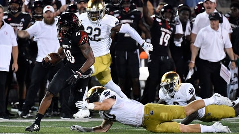 <p>               Notre Dame wide receiver Chris Finke (10) attempts to grab the feet of Louisville defensive back Trenell Troutman (20) during the first half of an NCAA college football game in Louisville, Ky., Monday, Sept. 2, 2019. (AP Photo/Timothy D. Easley)             </p>
