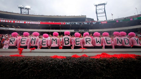 """<p>               Georgia fans observe a moment of silence in horror of Wendy Anderson, wife of Arkansas State head coach Blake Anderson before an NCAA college football game Saturday, Sept. 14, 2019, in Athens, Ga. Fans were encouraged to """"pink out"""" the stadium for Wendy Anderson who died from breast cancer in August. (AP Photo/John Bazemore)             </p>"""