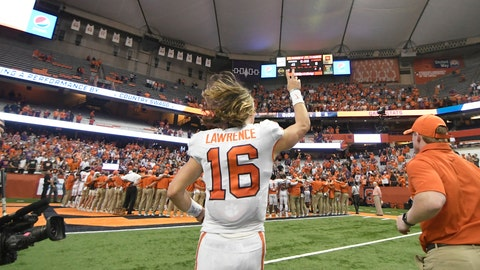 <p>               Clemson quarterback Trevor Lawrence leaves the field after the team's 41-6 win over Syracuse during an NCAA college football game Saturday, Sept. 14, 2019, in Syracuse, N.Y. (AP Photo/Steve Jacobs)             </p>