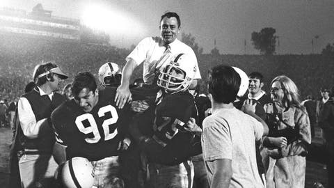 <p>               FILE - In this In this Jan. 1, 1971, file photo, Stanford coach John Ralston is carried off the field by his players after they defeated the Ohio State Buckeyes in the NCAA college football Rose Bowl game in Pasadena, Calif. Ralston, the former Stanford and Denver Broncos coach, died Saturday, Sept. 14, 2019, in Sunnyvale, Calif. He was 92. (AP Photo/File)             </p>