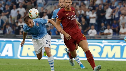 <p>               Roma's Edin Dzeko, left, challenges for the ball with Lazio's Stefan Radu during a Serie A soccer match between Lazio and Roma, at the Rome Olympic stadium, Sunday, Sept. 1, 2019. (AP Photo/Alessandra Tarantino)             </p>