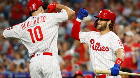 <p>               Philadelphia Phillies' J.T. Realmuto, left, and Bryce Harper celebrate after a home run by Realmuto during the first inning of a baseball game against the Atlanta Braves, Tuesday, Sept. 10, 2019, in Philadelphia. (AP Photo/Matt Slocum)             </p>