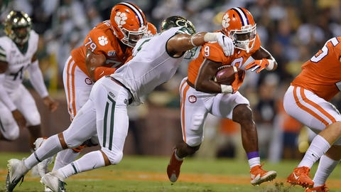 <p>               Clemson's Travis Etienne, right, rushes out of the tackle of Charlotte's Alex Highsmith, with blocking help from Jackson Carman (79) during the first half of an NCAA college football game Saturday, Sept. 21, 2019, in Clemson, S.C. (AP Photo/Richard Shiro)             </p>