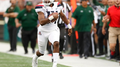 <p>               Arizona quarterback Khalil Tate (14) runs down the sideline during the second quarter during of the team's NCAA college football game against Hawaii on Saturday, Aug. 24, 2019, in Honolulu. (AP Photo/Marco Garcia)             </p>