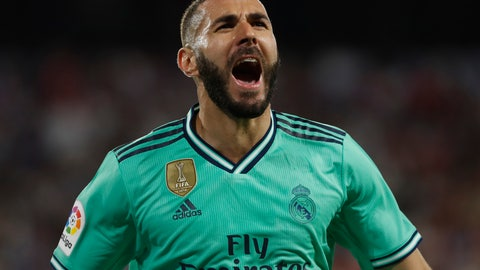 <p>               Real Madrid's Karim Benzema celebrates after scoring his side's opening goal during the Spanish La Liga soccer match between Sevilla and Real Madrid at the Ramon Sanchez Pizjuan stadium in Seville, Spain, Sunday, Sept. 22, 2019. (AP Photo/Miguel Morenatti)             </p>