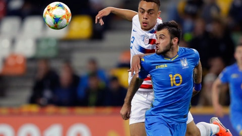 <p>               FILE - In this May 24, 2019, file photo, Ukraine's Serhii Buletsa, front, duels for the ball with United States' Sergino Dest during a Group D U20 World Cup soccer match in Bielsko Biala, Poland. Dest, an 18-year-old Ajax outside back eligible for the United States and the Netherlands, could make his U.S. debut in Friday's exhibition against Mexico but also has been in contact with the Dutch soccer federation. (AP Photo/Sergei Grits, File)             </p>