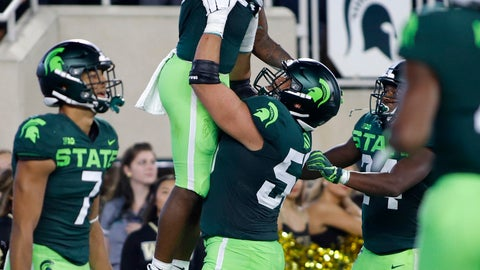<p>               Michigan State's Darrell Stewart is lifted by Jordan Reid as they celebrate Stewart's touchdown on a pass reception against Western Michigan during the first quarter of an NCAA college football game Saturday, Sept. 7, 2019, in East Lansing, Mich. (AP Photo/Al Goldis)             </p>