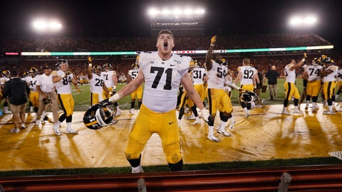 <p>               Iowa offensive lineman Mark Kallenberger celebrates at the end of the team's NCAA college football game against Iowa State, Saturday, Sept. 14, 2019, in Ames, Iowa. Iowa won 18-17. (AP Photo/Charlie Neibergall)             </p>