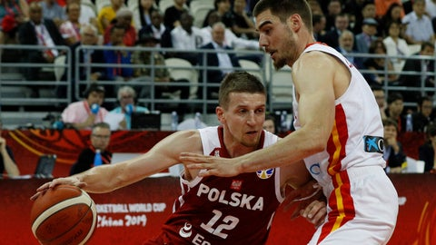 <p>               Adam Waczynski of Poland tries to pass through Juancho Hernangomez of Spain during their quarterfinals match for the FIBA Basketball World Cup at the Shanghai Oriental Sports Center in Shanghai, Tuesday, Sept. 10, 2019. (AP Photo/Andy Wong)             </p>