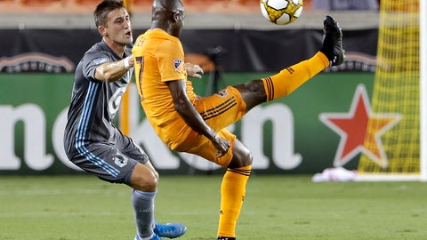 <p>               Houston Dynamo midfielder Boniek Garcia, right, brings down the ball in front of Minnesota United midfielder Ethan Finlay during the first half of an MLS soccer match Wednesday, Sept. 11, 2019, in Houston. (AP Photo/Michael Wyke)             </p>