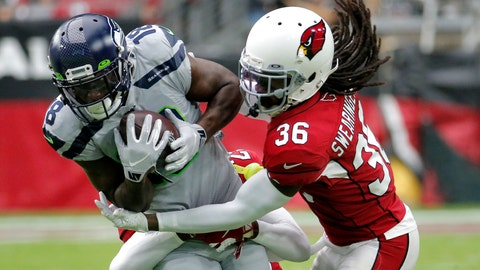 <p>               Arizona Cardinals free safety D.J. Swearinger (36) tackles Seattle Seahawks wide receiver Jaron Brown (18) during the first half of an NFL football game, Sunday, Sept. 29, 2019, in Glendale, Ariz. (AP Photo/Rick Scuteri)             </p>
