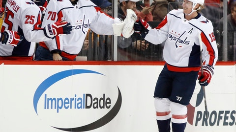 <p>               FILE - In this March 15, 2018, file photo, Washington Capitals center Nicklas Backstrom (19), of Sweden, is congratulated by right wing Devante Smith-Pelly (25) and goaltender Braden Holtby (70) after scoring during the second period of an NHL hockey game against the New York Islanders, in New York. The Washington Capitals are still a Stanley Cup contender a year removed from raising their first title banner in franchise history. (AP Photo/Kathy Willens, File)             </p>