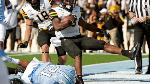 <p>               Appalachian State's Darrynton Evans (3) gets past North Carolina Tar Heels's Chazz Surratt (21) to score a touchdown during the first quarter of an NCAA college football game in Chapel Hill, N.C., Saturday, Sept. 21, 2019. (AP Photo/Chris Seward)             </p>