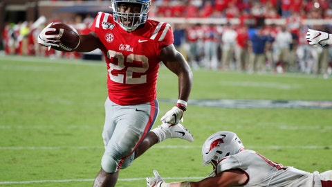 <p>               Mississippi running back Scottie Phillips (22) holds out his arm as he scores on a one-yard touchdown run past a fallen Arkansas defender during the second half of their NCAA college football game, Saturday, Sept. 7, 2019, in Oxford, Miss. Mississippi won 31-17. (AP Photo/Rogelio V. Solis)             </p>