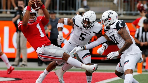 <p>               Ohio State quarterback Justin Fields, left, dives over the goal line past Cincinnati defensive back Darrick Forrest, center, and linebacker Dorian Holloway during the first half of an NCAA college football game Saturday, Sept. 7, 2019, in Columbus, Ohio. (AP Photo/Jay LaPrete)             </p>