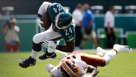 <p>               Philadelphia Eagles' Jordan Howard (24) is tackled by Washington Redskins' Jimmy Moreland (32) during the first half of an NFL football game, Sunday, Sept. 8, 2019, in Philadelphia. (AP Photo/Matt Rourke)             </p>