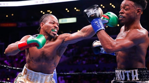<p>               Errol Spence Jr., right, and Shawn Porter exchange punches during the WBC & IBF World Welterweight Championship boxing match Saturday, Sept. 28, 2019, in Los Angeles. (AP Photo/Ringo H.W. Chiu)             </p>