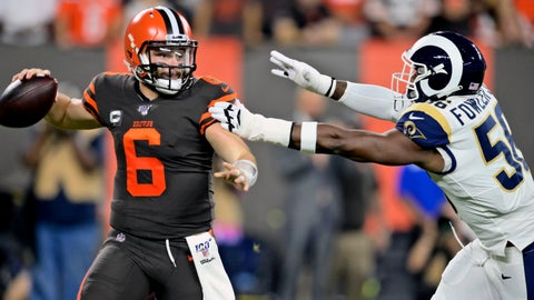 <p>               Cleveland Browns quarterback Baker Mayfield (6) looks to throw under pressure from Los Angeles Rams defensive end Dante Fowler during the first half of an NFL football game Sunday, Sept. 22, 2019, in Cleveland. (AP Photo/David Richard)             </p>