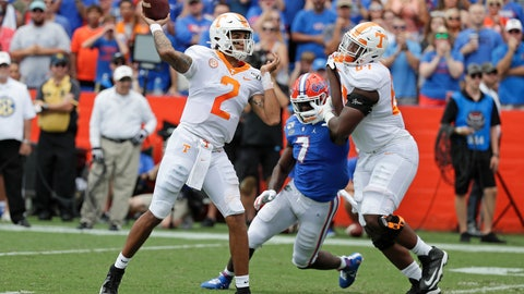 <p>               Tennessee quarterback Jarrett Guarantano (2) throws a pass as offensive lineman Wanya Morris, right, tries to block Florida linebacker Jeremiah Moon (7) during the first half of an NCAA college football game, Saturday, Sept. 21, 2019, in Gainesville, Fla. (AP Photo/John Raoux)             </p>