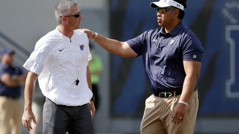 <p>               FILE - In this Oct. 14, 2017, file photo, Memphis head coach Mike Norvell, left, and Navy head coach Ken Niumatalolo talk before an NCAA college football game, in Memphis, Tenn. Three undefeated teams are left in the American Athletic Conference and two of them face each other Thursday, Sept. 26, 2019, to open this week's AAC slate.  Navy (2-0, 1-0 AAC) with its sometimes-baffling triple option offense visits Memphis for the ESPN-televised game, and only one will emerge to join SMU as the undefeated teams left in the conference. (AP Photo/Mark Humphrey, File)             </p>
