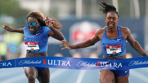 <p>               FILE- In this July 26, 2019, file photo, Teahna Daniels, right, beats Morolake Akinosun, left, to the finish line, winning the women's 100-meter dash at the U.S. Championships athletics meet in Des Moines, Iowa. Daniels is the newest American sprinter on the scene. (AP Photo/Charlie Neibergall, File)             </p>