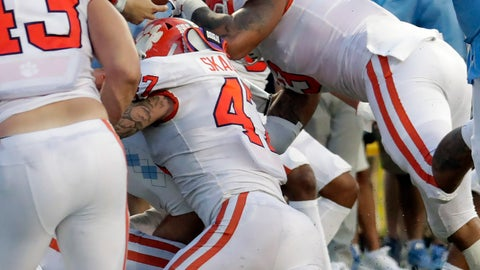 <p>               North Carolina's Sam Howell (7) gets stopped on a two-point conversion by Clemson's James Skalski (47) and Xavier Thomas (3) in the fourth quarter of an NCAA college football game in Chapel Hill, N.C., Saturday, Sept. 28, 2019. (AP Photo/Chris Seward)             </p>