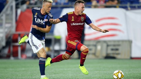 <p>               Real Salt Lake forward Corey Baird, right, is defended by New England Revolution defender Antonio Mlinar Delamea, left, during the first half of an MLS soccer match at Gillette Stadium, Saturday, Sept. 21, 2019, in Foxborough, Mass. (AP Photo/Stew Milne)             </p>